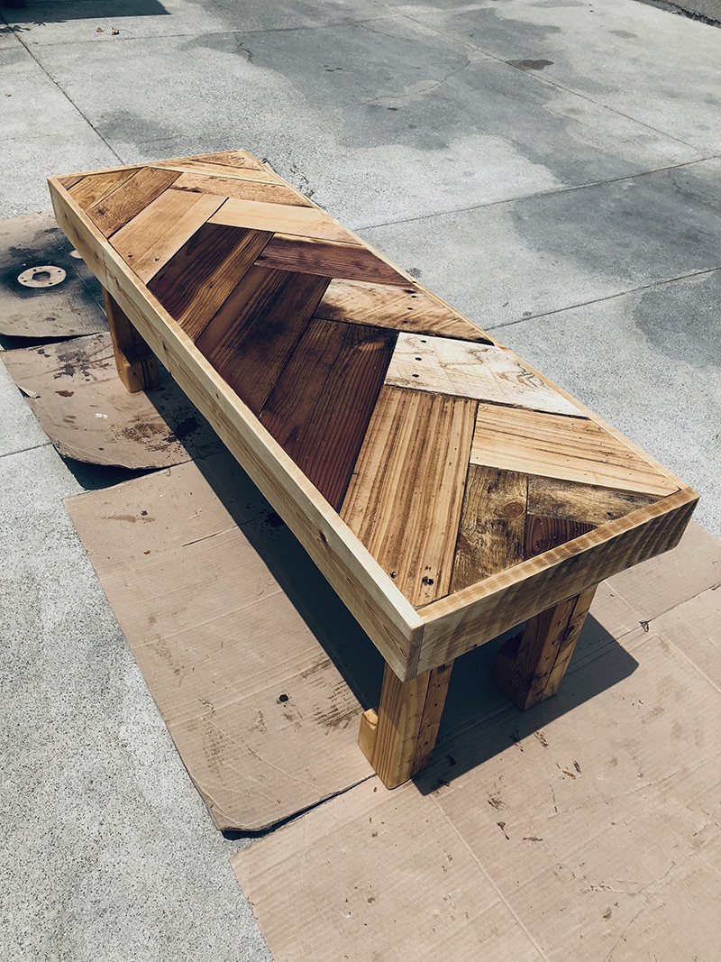 DIY chevron coffee table made from upcycled wood and pallets. Created by Jeremy Schuler.